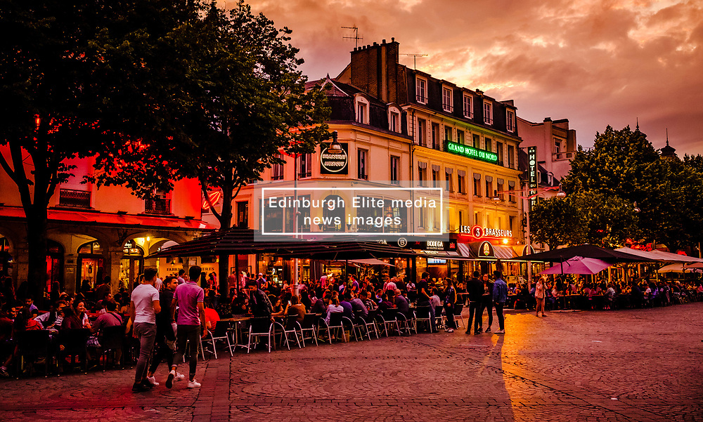People enjoying the cafes and restaurants in the Place Drouet d'Erlon, Reims, France during the eveming.<br /> <br /> (c) Andrew Wilson | Edinburgh Elite media