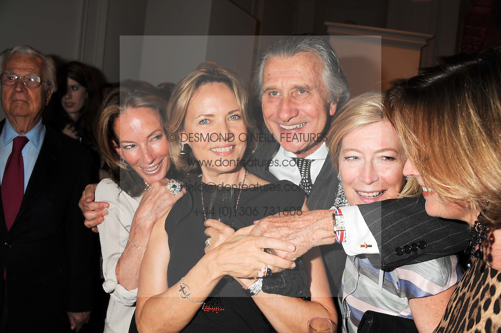 Left to right, ANNE SUMMERS, CARLA BAMBERGER, ARNAUD BAMBERGER Executive Chairman Cartier UK, ANNE SINGER and LOUISE DEL BALZO  at a reception to present the new Cartier Tank Watch Collection held at The Orangery, Kensington Palace Gardens, London W8 on 19th April 2012.