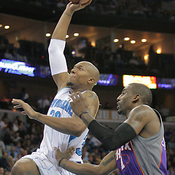 03 December 2008:  New Orleans Hornets forward David West (30) drives past Phoenix Suns forward Amare Stoudemire (1) during a 104-91 victory by the New Orleans Hornets over the Phoenix Suns at the New Orleans Arena in New Orleans, LA..