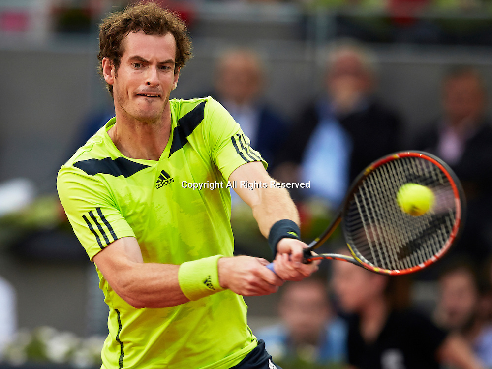 07.05.2014 Madrid, Spain. Andy Murray of Great Britain plays a double handed backhand during the game with Nicolas Almagro of Spain on day 4 of the Madrid Open from La Caja Magica.