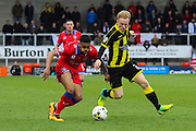 Oldham's Tereiq Holmes-Dennis and Burton Albion forward Mark Duffy challenge for the ball during the Sky Bet League 1 match between Burton Albion and Oldham Athletic at the Pirelli Stadium, Burton upon Trent, England on 26 March 2016. Photo by Aaron Lupton.