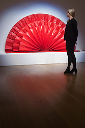 "Bonhams, Mayfair, London. A woman admires an Untitled ""red fan"" sculpture estmated at £1.5 - 2 million by Kazuo Shiraga to be auctioned at Bonhams post-war and Contemporary art sale.  //FOR LICENCING CONTACT: paul@pauldaveycreative.co.uk TEL:+44 (0) 7966 016 296 or +44 (0) 20 8969 6875. ©2015 Paul R Davey. All rights reserved.///FOR LICENCING CONTACT: paul@pauldaveycreative.co.uk TEL:+44 (0) 7966 016 296 or +44 (0) 20 8969 6875. ©2015 Paul R Davey. All rights reserved."