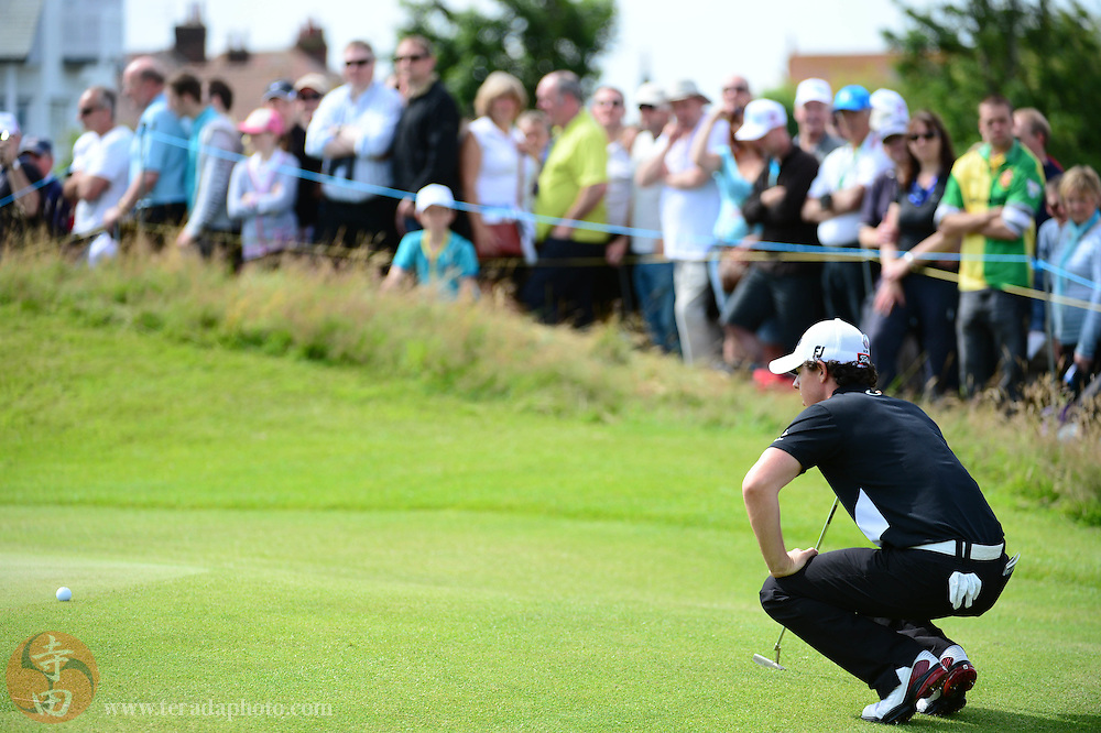 July 21, 2012; St. Annes, ENGLAND; Rory McIlroy lines up his putt on the 4th hole during the third round of the 2012 British Open Championship at Royal Lytham & St. Annes Golf Club.
