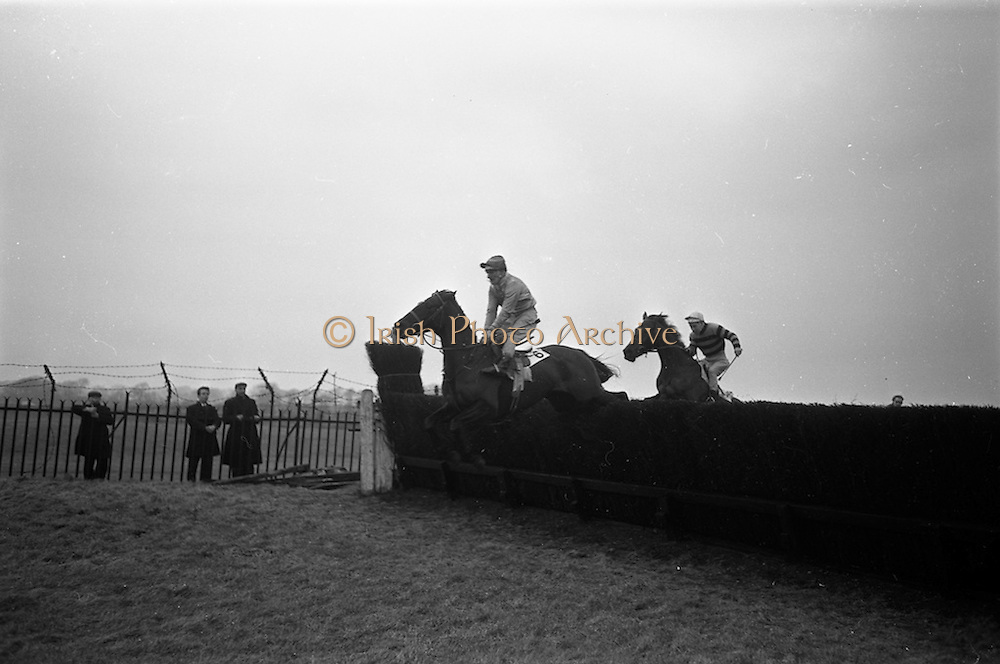 "16/02/1963<br /> 02/16/1963<br /> 16 February 1963<br /> Horse Racing at Baldoyle racecourse, Dublin. Picture shows ""Jungle Trix"" (J.J. Rafferty up) coming over the last jump in front of ""Brown Diamond"", (winner) (F. Shortt up) in the Baldoyle Handicap Chase."