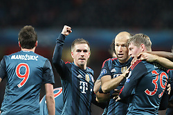 19.02.2014, Emirates Stadion, London, ENG, UEFA CL, FC Arsenal vs FC Bayern Muenchen, Achtelfinale, im Bild l-r: Torjubel von Mario MANDZUKIC #9 (FC Bayern Muenchen), Philipp LAHM #21 (FC Bayern Muenchen), Arjen ROBBEN #10 (FC Bayern Muenchen), Toni KROOS #39 (FC Bayern Muenchen) // during the UEFA Champions League Round of 16 match between FC Arsenal and FC Bayern Munich at the Emirates Stadion in London, Great Britain on 2014/02/19. EXPA Pictures © 2014, PhotoCredit: EXPA/ Eibner-Pressefoto/ Kolbert<br /> <br /> *****ATTENTION - OUT of GER*****