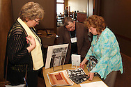(from left at table) Dolores (Rehling) Kulhanek (chorus member 1959-1967,) Jerry Alred (member 1951 - 1959) and Fran Walker (chorus member 1957-1966) look at items that Walker brought to a reunion of Inland Children's Chorus members at MCL Restaurant & Bakery in Kettering, Saturday, April 27, 2013.