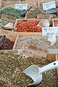 Dried goods, spices and condiments on display for sale on market stall at old street market - Mercado -  in Ortigia, Syracuse, Sicily