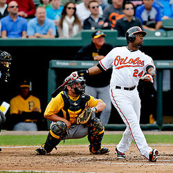 Mar 1, 2013; Sarasota, FL, USA;Baltimore Orioles third baseman Wilson Betemit (24) hits a solo homerun during the bottom of the second inning of a spring training game against the Pittsburgh Pirates at Ed Smith Stadium. Mandatory Credit: Derick E. Hingle-USA TODAY Sports