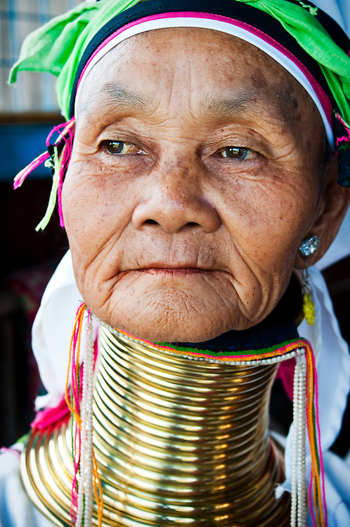 """Portrait of a senior woman from the Padaung tribe (a.k.a. """"Long Neck"""" tribe) at Inle Lake, Myanmar"""