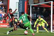 AFC Bournemouth's defender Sylvain Distin (left) makes a defensive tackle against Sunderland AFC midfielder Jeremain Lens during the Barclays Premier League match between Bournemouth and Sunderland at the Goldsands Stadium, Bournemouth, England on 19 September 2015. Photo by Mark Davies.