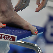 A swimmers big toe on the blocks during swim training at the Aquatic Centre at Olympic Park, Stratford during the London 2012 Olympic games preparation at the London Olympics. London, UK. 25th July 2012. Photo Tim Clayton