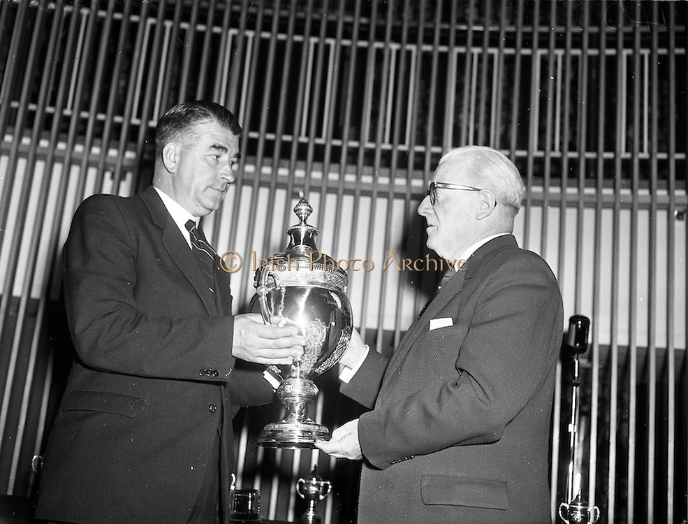 """27/05/1959<br /> 05/27/1959<br /> 27 May 1959<br /> Presentation of Esso Perpetual Trophy to the Listowel Drama Group at the Shelbourne Hotel, Dublin. The trophy and replicas for the  All Ireland Amateur Dram festival were presented by Mr. T.F. Laurie, Chairman and Managing Director of Esso Petroleum Co. (Ireland) Ltd. at a special luncheon. The Listowel group won the competition with their performance of the 3 Act play """"Sive"""" by John B. Keane. Picture shows Mr. Laurie presenting the trophy to Mr Bryan McMahon, President Listowel Drama Group."""