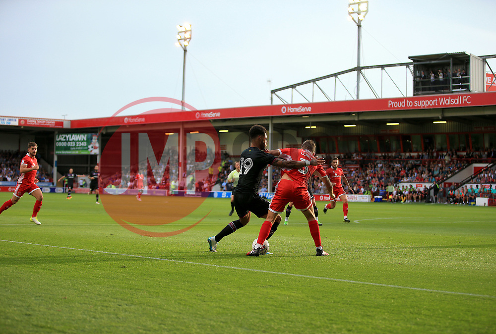 Andre Green of Aston Villa turtles with Luke Leahy of Walsall under he floodlights of the Bescot Stadium - Mandatory by-line: Paul Roberts/JMP - 18/07/2017 - FOOTBALL - Bescot Stadium - Walsall, England - Walsall v Aston Villa -  Pre-season friendly