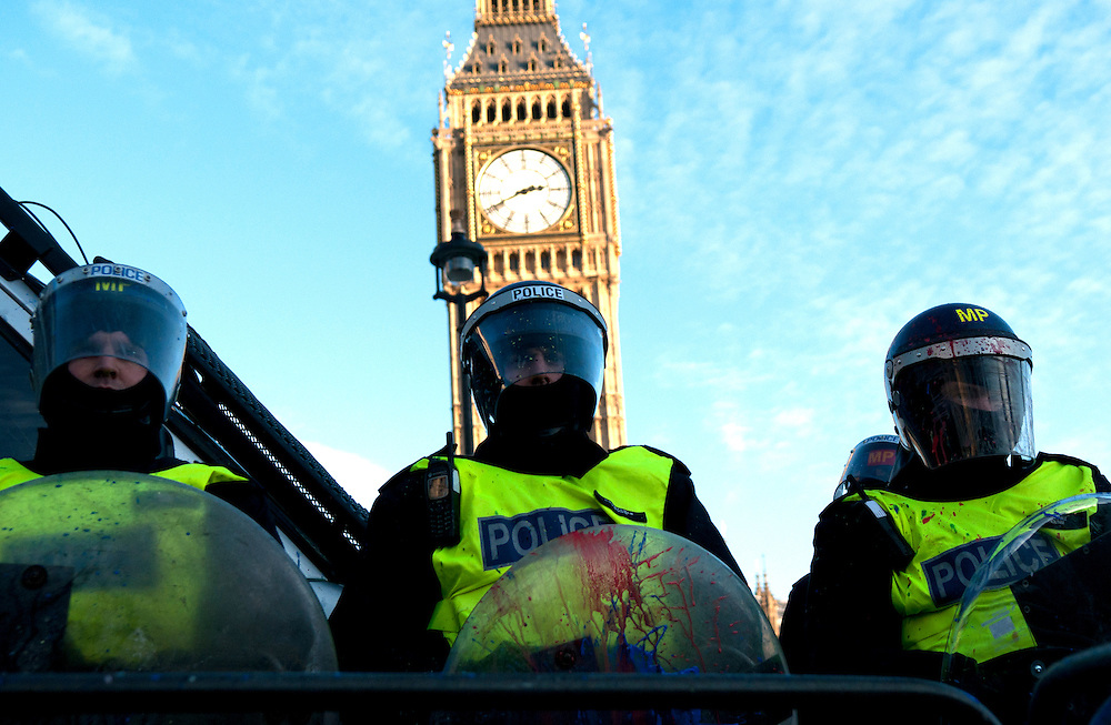 Students thew paint at police in front of Parliament in London. Students gathered for the fourth time in as many weeks to protest the proposed rise in tuition fees.