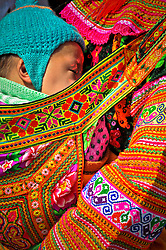 Hmong mother carries her sleeping infant on her back, Nha Trang beach, Khanh Hoa Province, Vietnam, Southeast Asia