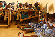 Girls sit on the floor because of a shortage of seats as they attend class at the Faye primary school in the town of Faye, Bas-Sassandra region, Cote d'Ivoire on Monday March 5, 2012. The class has 79 students, and the school has been forced to refuse any additional students.