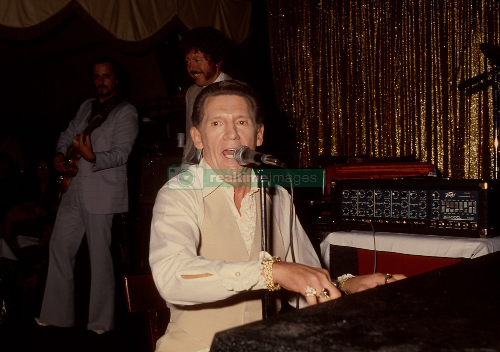 Aug 18, 2003; Memphis, TN, USA; (FILEPHOTO) Singer JERRY LEE LEWIS in Memphis in the late 1980's. Lewis has endured a life of drugs and bad luck. His first son died in a car accident following a bout with drugs and mental illness, Lewis was arrested for waving a gun outside Elvis' graceland estate, accidentally shot his own bass player (who survived and sued), was on the run from the IRS, almost died from an ulcer, lost two of six wives in a year due to drugs and survived a pain killer addiction thanks to the Betty Ford Clinic..  (Credit Image: Robin Rayne/ZUMAPRESS.com)