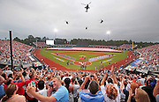 Fayetteville, NC - July 3, 2016: A packed crowd watch helicopters perform a flyover prior to Sunday's Major League baseball game between the Atlanta Braves and the Florida Marlins at Fort Bragg Field. (Gerry Melendez for ESPN)
