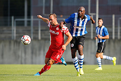 "26.07.2014, Paul-Janes-Stadion, Duesseldorf, GER, FS Vorbereitung, Testspiel, Fortuna Duesseldorf vs Wigan Athletic, im Bild Erwin ""Jimmy"" Hoffer (Fortuna Duesseldorf #9) im Zweikampf gegen Emmerson Boyce (Wigan Athletic #17) // during a Friendly Match between Fortuna Duesseldorf and Wigan Athletic at the Paul-Janes-Stadion in Duesseldorf, Germany on 2014/07/26. EXPA Pictures © 2014, PhotoCredit: EXPA/ Eibner-Pressefoto/ Schueler<br /> <br /> *****ATTENTION - OUT of GER*****"