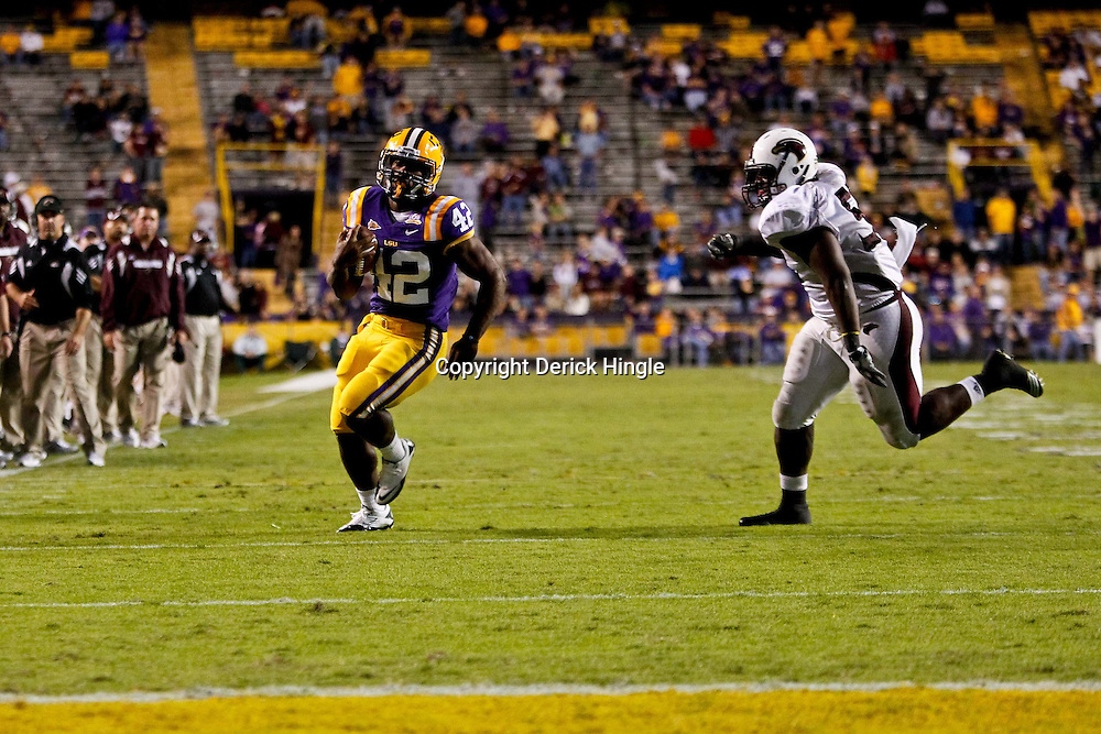 November 13, 2010; Baton Rouge, LA, USA;  LSU Tigers running back Michael Ford (42) runs for a touchdown against the Louisiana Monroe Warhawks during the second half at Tiger Stadium. LSU defeated Louisiana-Monroe 51-0.  Mandatory Credit: Derick E. Hingle