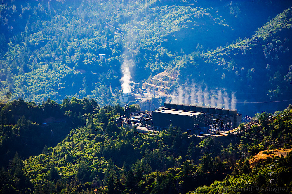 Geothermal electricity power plant in forested, mountainous area