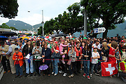 Fans wait for Cancellara to hit the podium on the shores of lake Lugano.