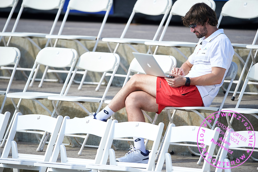 KAILUA KONA, USA - 2016 FEBRUARY 04: Physiotherapist Krzysztof Guzowski works on laptop while training session on two days before the Fed Cup World Group II 1st round tennis match between USA and Poland on February 04, 2016 at Holua Tennis Center in Kailua Kona, USA.<br /> <br /> Picture also available in RAW (NEF) or TIFF format on special request.<br /> <br /> Any editorial, commercial or promotional use requires written permission from the author of image.<br /> <br /> Adam Nurkiewicz declares that he has no rights to the image of people at the photographs of his authorship.<br /> <br /> Mandatory credit:<br /> Photo by &copy; Adam Nurkiewicz / Mediasport