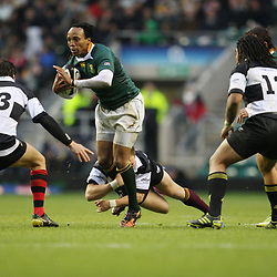 LONDON, ENGLAND - DECEMBER 04,Odwa Ndungane looking to get out of a tackle  during the End of Year tour match between Barbarians and South Africa at Twickenham Stadium on December 04, 2010 in London, England<br /> Photo by Steve Haag / Gallo Images