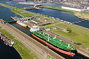 Nederland, Noord-Holland, Gemeente Velsen, 09-04-2014; Noordzeekanaal met sluizen IJmuiden. Noordersluis. Spuisluis en Tata Steel (Hoogovens) in de achtergrond<br /> Entrance Noorzee-channel with locks and Tata Steel (background).<br /> luchtfoto (toeslag op standard tarieven);<br /> aerial photo (additional fee required);<br /> copyright foto/photo Siebe Swart