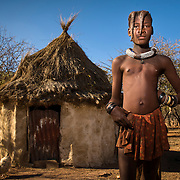 Himba boy in a village near Kamanjab
