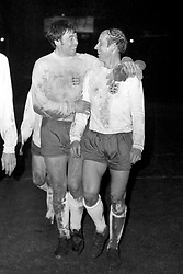 England goalkeeper Gordon banks walks off the pitch with Bobby Charlton, who was captain for his 100th International. England won the match 3-1 with Bobby Charlton scoring the third goal.