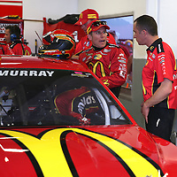 Racecar driver Jamie McMurray is seen entering his car  in his garage area during the  56th Annual NASCAR Daytona 500 practice session at Daytona International Speedway on Wednesday, February 19, 2014 in Daytona Beach, Florida.  (AP Photo/Alex Menendez)