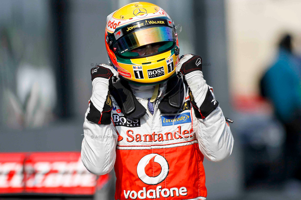 Lewis Hamilton of Vodafone McLaren Merceds reacts after he clocked the fastest time during the qualifying session at the Sepang circuit, outside Kuala Lumpur, Malaysia, 23 March 2012. The Formula One Grand Prix of Malaysia will take place on 25 March 2012.