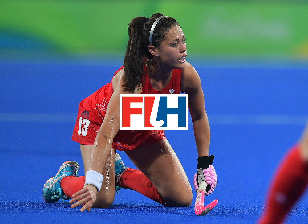 Britain's Sam Quek looks on after falling during the women's field hockey Britain vs Australia match of the Rio 2016 Olympics Games at the Olympic Hockey Centre in Rio de Janeiro on August, 6 2016. / AFP / Carl DE SOUZA        (Photo credit should read CARL DE SOUZA/AFP/Getty Images)