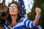 27 AUGUST 2012 - GILBERT, AZ: SARAH PALIN speaks at a Republican campaign event Monday. Sarah Palin campaigned for Arizona Republicans aligned with the Tea Party movement at a barbecue in Gilbert, AZ, a suburb of Phoenix. She campaigned for Kirk Adams, who is running for Congress and Jeff Flake, who is running for US Senate. Palin spoke and served barbecued chicken in 108 degree heat.       PHOTO BY JACK KURTZ