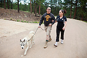 John Daniel Shannon, 48, a former US Army Senior Sniper, is walking Miko, his loyal Akita dog, with his wife, Torrey Shannon, 42, near his home in Westcliffe, CO, USA, where he retired with his family after a serious brain injury inflicted by an insurgent sniper in Ramadi, Al Anbar Province, Iraq, on November 13th 2004. Daniel fought during the Second Battle of Fallujah and was then moved to nearby Ramadi. Daniel lost his left eye and has multiple health issues because of his injury: memory problems, balance problems, he can't smell and taste well anymore, he suffers from PTSD, has  troubles with large crowds and city surroundings. This is the reason why he and his family moved to a quiet location on the Rocky Mountains. In 2007 Dan helped the Washington Post to uncover patients' neglect at the Walter Reed Army Medical Center; he also testified before Congress. Torrey, his wife, is a freelance writer and a contributor for the Huffington Post; she's also campaigning to improve the situation of veterans' families.