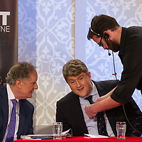 Clare TD Michael McNamara gets miked up after arriving late to the The People's Debate with Vincent Browne at the Auburn Lodge Hotel on Friday 16th January