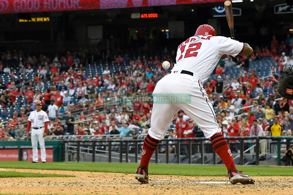 May 6, 2018 - Washington, DC, U.S. - WASHINGTON, DC - MAY 06:  Washington Nationals first baseman Howie Kendrick (12) is hit by a pitch in the ninth inning during the game between the Philadelphia Phillies  and the Washington Nationals on May 6, 2018, at Nationals Park, in Washington D.C.  The Washington Nationals defeated the Philadelphia Phillies, 5-4.  (Photo by Mark Goldman/Icon Sportswire) (Credit Image: © Mark Goldman/Icon SMI via ZUMA Press)
