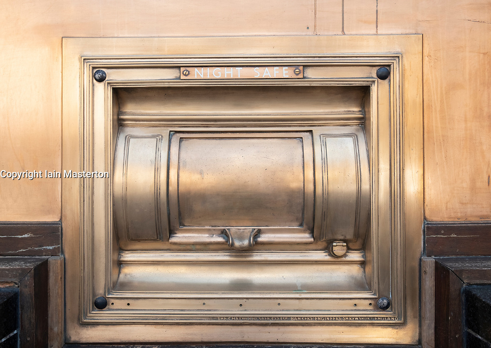 View of old brass night safe outside bank