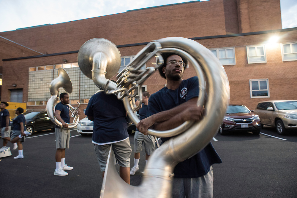 WASHINGTON,DC - October 5, 2017: Erik Cooper spins his tuba to clear some of the saliva before the band starts marching during practice on Thursday night. Howard University's Showtime Marching Band is part of a long tradition of outstanding bands at HBCU's. The band practices in the days leading up to a home game against North Carolina Central. (André Chung for The Undefeated)