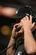Apr 28, 2017; Phoenix, AZ, USA; Second base umpire Jerry Layne (24) puts on headphones for an official review of a call made during the game between the Colorado Rockies and Arizona Diamondbacks at Chase Field. Mandatory Credit: Jennifer Stewart-USA TODAY Sports
