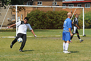 Deportivo Colomex Goalkeeper Jose Carmona puts the ball back into play against Team Shlama F.C. during National Soccer League play in Skokie, Il.