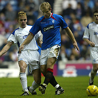 Rangers v St Johnstone....03.12.03<br />Egil Ostenstad is tackled by Ryan Stevenson<br /><br />Picture by Graeme Hart.<br />Copyright Perthshire Picture Agency<br />Tel: 01738 623350  Mobile: 07990 594431