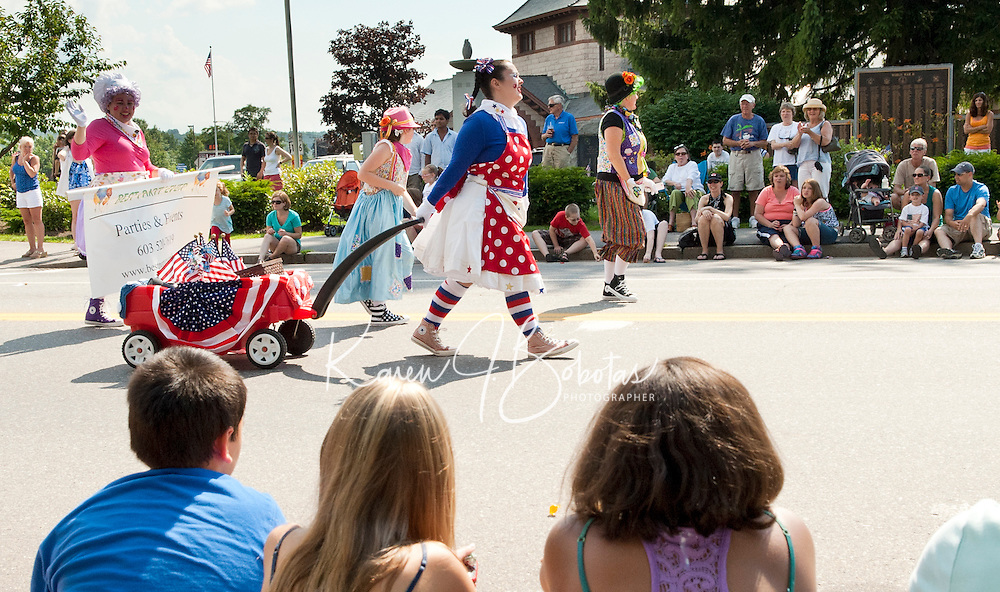 Folks lined the streets at Veterans Square for the annual July 4th Parade Monday afternoon.  (Karen Bobotas/for the Laconia Daily Sun)
