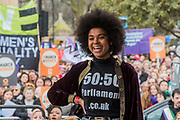 Isabel Adomakoh Young - 50/50 - 'Ask her to stand' - #March4Women 2018, a march and rally in London to celebrate International Women's Day and 100 years since the first women in the UK gained the right to vote.  Organised by Care International the march stated at Old Palace Yard and ended in a rally in Trafalgar Square.