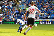 Leandro Bacuna (7) of Cardiff City shoots at goal during the EFL Sky Bet Championship match between Cardiff City and Middlesbrough at the Cardiff City Stadium, Cardiff, Wales on 21 September 2019.