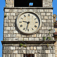 Clock Tower in Kotor, Montenegro<br /> A dominate feature of Trg od Oružja, which is Koto's largest square, is the Clock Tower. It was built in 1602. The current two faces were added in 1810. In front is a pillory once used to tie up prisoners while they were abused and publically ridiculed.  From this point roads lead in four directions through Stari Grad or the Old Town. Each path has its own visual rewards so just start wandering.
