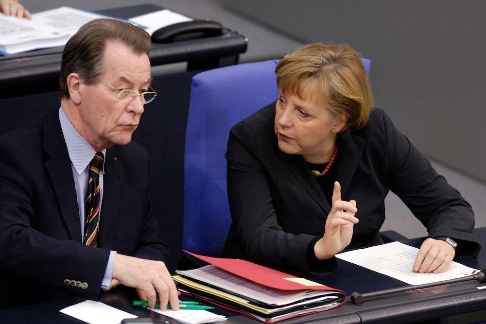 09 FEB 2006, BERLIN/GERMANY:<br /> Franz Muentefering (L), SPD, Bundesarbeitsminister, und Angela Merkel (R), CDU, Bundeskanzlerin, im Gespraech, vor Beginn einer aktuelle Stunde zur Erhoehung des Renteneintrittsalters auf 67 Jahre, Plenum, Deutscher Bundestag<br /> IMAGE: 20060209-02-034<br /> KEYWORDS: Franz M&uuml;ntefering, Gespr&auml;ch, Zeigefinger, Finger