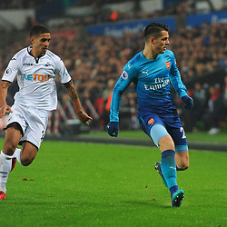 Granit Xhaka of Arsenal runs with the ball under pressure from Kyle Naughton of Swansea City during Swansea City vs Arsenal, Premier League, 30.01.18 (c) Harriet Lander | SportPix.org.uk