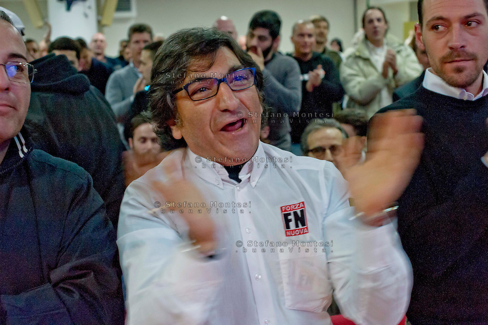 Roma 1 Marzo 2014<br /> Riunione  dei partiti dell'ultradestra europea  per un convegno dal titolo &ldquo;L&rsquo;Europa Risorge&rdquo;. Un militante di Forza Nuova<br /> Rome, March 1, 2014<br /> Meeting of the ultra-right European parties for a conference entitled &quot;Europe resurrects&quot;.<br /> A militant of New Force ( Forza Nuova ) applaud the speakers of the conference
